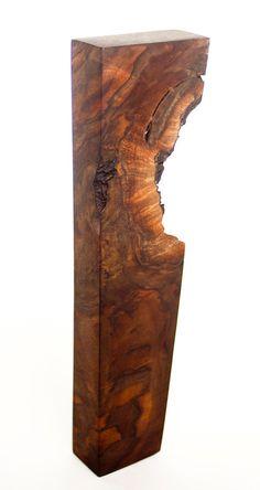 Natural wood beer tap handle.