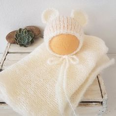 Newborn Bear bonnet and Mohair stretch wrap set  Made in a soft brushed South African Mohair. Very soft and sweet.  A lovely photo prop for your stash, or for a new baby  Gently wash , and lay flat to dry  The photos with the babies are to show the fit. You are ordering the cream bonnet and wrap  Shipping from South Africa to the UK is approx 14 business days, Elsewhere up to 25 business days, so please bear that in mind when ordering. Join me on Facebook to get all the latest news…