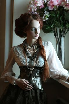 Victorian Steampunk fashion...perfect contrast of overly. Feminine with the layers of pearls paired with the leather bustier.