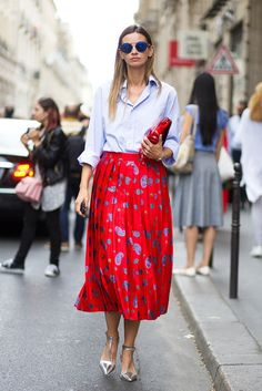 Le Fashion Blog Street Style Sunglasses Blue Button Down Shirt Clutch Bright Red Printed Midi Skirt With Pleats Metallic Silver Heels Via Harpers Bazaar
