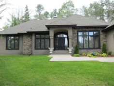 Taupe w/ black trim - No White. sections of stone ground to roof  colors - taupes with black windows
