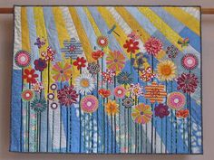Whimsical Garden 5 wall quilt by Tina Curran.  I like how she pieced her background fabric for this applique flower quilt