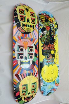 """The deck on the left is absolutely brilliant.  The colors look like they came out of a malfunctioning arcade machine and the art leaps off the boards, with a simple, yet shockingly surreal appearance. From a distance it would grab your attention and really make you think """"Whoa what am I looking at?"""" and when you get close enough to see the finer details you'll say """"I still don't know what I'm looking at but it's really awesome!"""""""