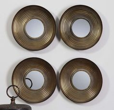 This circle in a square combines modern finishes with global style. http://www.myswankyhome.com/tondela-round-mirrors-set-4/