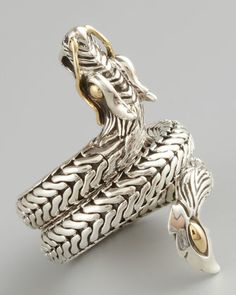 john hardy, naga dragon coil ring, reissued in honour of the lunar year of the dragon.    sterling silver with 18k yellow gold details.    (neiman marcus, $495)