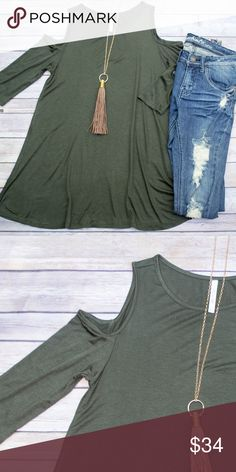 Cold Shoulder Tunic - Olive Loose fitting tunic with cold shoulders. This is the perfect base layer for fall! Goes great with leggings, leggings, you name it! Also comes in black, gray, burgundy, mauve, and navy. Please see individual listings to purchase other colors. No trades. Kyoot Klothing Tops Tunics