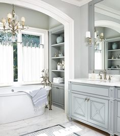 """It's neutral enough to feel and look timeless,"" @annehepfer says of the blissful master bath she designed for a jet-setting family's Toronto home base. Photo by @virginmacdonald"