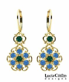 Lucia Costin 14K Yellow Gold over .925 Sterling Silver Flower Shaped Dangle Earrings with 6 Petal Middle Flower , Ornate with Blue and Emerald Green Swarovski Crystals; Handmade in USA Lucia Costin. $54.00. Flowers and fancy ornaments beautifully combined. Amazingly designed with blue and emerald green Swarovski crystals. Unique jewelry handmade in USA. Irresistible Dangle earrings by Lucia Costin. Update your everyday style with inspiration when wearing this piece ...