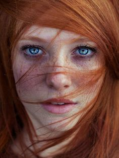 Asima Sefic, a redhead with freckles and blue eyes,