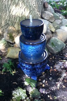 Blue Planters Waterfall:  Let your fountain add a pop of color to your garden! This royal blue waterfall was crafted with three giant planter pots, and it looks absolutely lovely.
