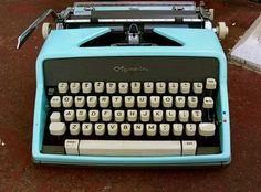typewriter  is a mechanical or electromechanical machine for writing in characters similar to those produced by printer's movable type by means of keyboard-operated types striking a ribbon to transfer ink or carbon impressions onto the paper.