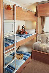 An example of one of our caravans with the triple bunk layout