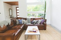 a leather sectional sofa from Pottery Barn-Eclectic Living Room by Heather Banks