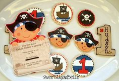 Very cute pirate face and ship  cookies