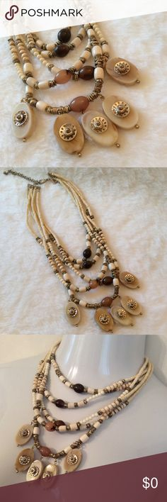 | CHICO'S | neutral BOHO bib statement necklace Worn once. Multi Neutral Beaded Statement Necklace from Chico's. Set in Goldtone Metal. This is a definite BOHO Statement Piece.                                               ➖PRICE FIRM ((unless bundled))➖ Chico's Jewelry Necklaces