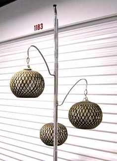 Mid-century tension pole lamp with globes.