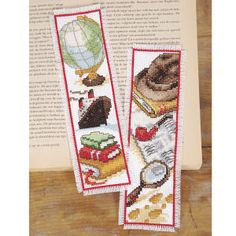 "Time to Travel Bookmarks  JUST THE TICKET, bookmarks for your travel log, favorite mystery novel and more. Counted cross stitch kit includes 14-count white Aida cloth, presorted DMC cotton floss, needle, chart and instructions. Set of two, each 2 1/2"" x 8"". Imported from Belgium. A Stitchery exclusive!	      ****   Time to Travel Bookmarks  Item #: T25221  Price: $19.99"