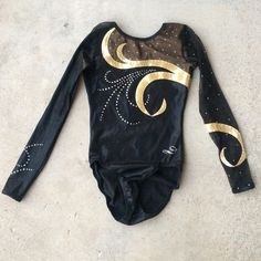 Shop Kids' dreamlight activewear Gold Black size Adult XS Dance at a discounted price at Poshmark. Gymnastics Competition Leotards, Gymnastics Suits, Gymnastics Workout, Gymnastics Girls, Gymnastics Leotards, Active Wear, Black Leotard, Long Sleeve Leotard, Black Kids