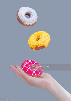 View top-quality stock photos of Female Hand Hold Pink Doughnut Yellow White Donuts Flying Trendy Levitation Blue Gray Background. Find premium, high-resolution stock photography at Getty Images. Levitation Photography, Fruit Photography, Flat Lay Photography, Donut Pictures, Colorful Donuts, Take Out Containers, Cute Donuts, Caking It Up, All Themes