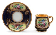 A CUP WITH A SAUCER.  Porcelain. Deutsche Blumen-decor and gildings on dark blue background. Kornilov, Russia. Late 19th century. Height 8 cm.