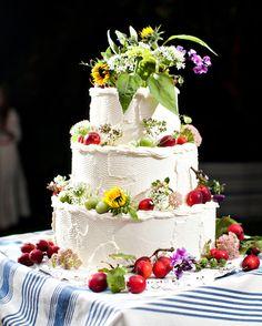 Swan's Way created this large, textured, three-tiered vanilla and lemon cake…