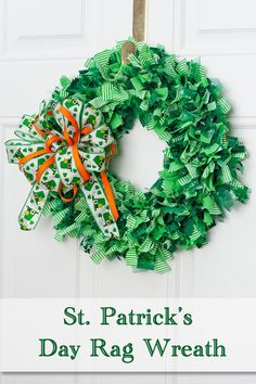 Green Rag Wreath on a white door. The wreath is embellished with a leprechaun hat and orange bow.