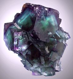 Fluorite cubes with modified edges From the Okorusu Mine, Otjiwarongo Region, Karibib District, Namibia. Measures 8 cm by 7.1 cm by 5 cm in size.