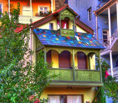 Colorful buildings in Tbilisi, Georgia (by (Why are there so many white houses on our planet? Fear of color or fear of commitment? Precisely what color could be more boring? Colourful Buildings, Beautiful Buildings, Beautiful Places, Colorful Houses, Unusual Buildings, Beautiful Architecture, Malta, Places Around The World, Sweet Home