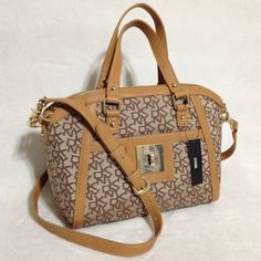 """DKNY Chino-Tan Combination Crossbody Satchel DKNY Chino-Tan Combination Crossbody Satchel   • RETAILS @ $325.00 • Condition: NEW WITH TAGS, NO defects • Color: Chino-Tan • Dimensions: 11""""W x 9""""H x 6""""D • Double handle length: 13"""" • Double handle drop: 5"""" • Adjustable/Removable Xbody shoulder strap total length 52"""" • Interior: 1 zipper compartment and 2 slip pockets • Gold tone hardware (no scratches, has protective clear plastic film cover)  ❌NO TRADES ❌NO PAYPAL ❌NO HOLDS DKNY Bags Crossbody…"""