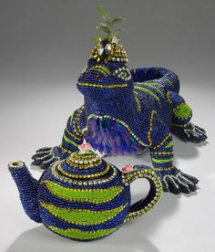 Nancy Josephson is bead artist who makes wonderful and really uniqe beaded art  like decorative different things for interior, beaded animals, birds, candlestick, mirrors and even urns! Love her work!!