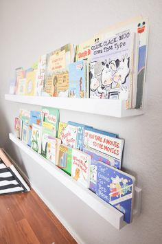 Create gorgeous DIY Kid's Bookshelves with this easy project. These wall shelves designed for children's books are the perfect room decor solution for kid's rooms. Kids can see all their books on these Montessori style floating shelves. Kids bookcases can inspire creativity and a love of learning. Make these DIY white bookshelves in just an afternoon. DIY Wall Mounted Kid's Bookshelves. Your children will love these decorative shelves for their bedroom or playroom. - Our Handcrafted Life