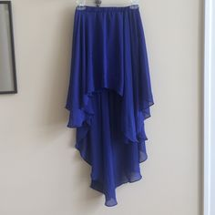 Royal Blue High Low Skirt Very pretty royal blue high-low/hi-low skirt. Worn maybe 3 times. Great condition. Elastic band. Sheer material creates a sexy, sassy look. Medium. Heart Soul Skirts High Low