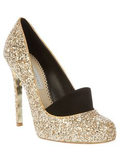 Gold tone glitter encrusted pumps from Stella McCartney featuring an almond toe, stiletto heel and a faux suede front detail.. I'm in <3