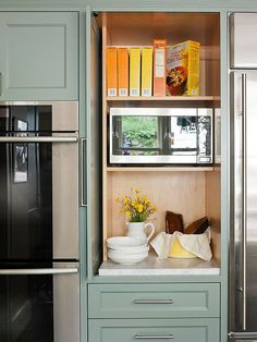 Give your kitchen a clean look by concealing the microwave. This microwave fits snugly into an empty cubby in the appliance garage. A handy slide-back door keeps the appliance accessible without taking up a single inch of traffic space in the kitchen's main work zone.