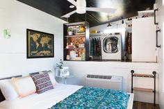For storage, Kim Lewis Designs used the space in a raised area of the bedroom to create a walk-in closet.