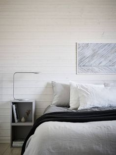 Fresh looking bedroom with a light wooden wall