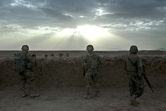 24 hours in pictures: US soldiers and an Afghan colleague in Kandahar province
