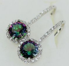 Stunning fashion sparkling earrings made with Rainbow Mystic Topaz CZ, surrounded by simulated white topaz. Crystal paved on the hook too.  Metal parts are sterling silver filled and rhodium plated fo