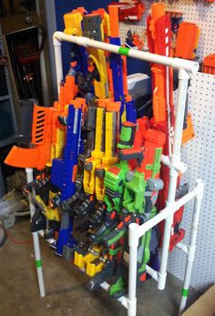Nerf Gun storage using PVC Pipe. Cheap, portable, and easily customized. Nerf Gun storage using PVC Pipe. Cheap, portable, and easily customized. This is version 3 o Nerf Gun Storage, Diy Toy Storage, Wall Storage, Storage Ideas, Storage Baskets, Nerf Birthday Party, Nerf Party, Gun Decor, Pvc Pipe Projects