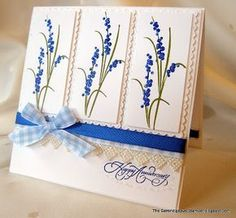 """Stamp 3 images and die cut with Spellbinders Long Classic Rectangles;  popped up on Long Classic Scalloped Rectangles.     Stardust Stickles to the blue flowers.  I also Stickled around the Scalloped Rectangles and around the bottom of the sentiment.  Sentiment is from a new Rubbernecker set """"Best Wishes Set Sku:600"""".  I stamped it on the bottom of my card stock and layered Maya Road Lace and Micheal's ribbon. Stardust Stickles around the Scalloped Rectangles and the bottom of the sentiment."""