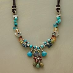 """GREEN PASTURES NECKLACE--Leather reins give way to a field of bluegrass dotted with wildflower gemstones. Handmade exclusive includes turquoise, apatite, peridot, citrine, garnet, moss aquamarine, blue quartz, London blue topaz, labradorite moonstone and sterling silver beads. Lobster clasp. 18"""" to 20""""L."""