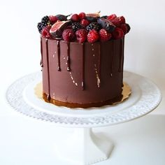 Chocolate mud cake filled with chocolate buttercream, covered in a rich dark chocolate ganache. Topped with fresh fruit and gold.