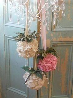 Shabby chic rosette and lace flower balls on ribbon swags.