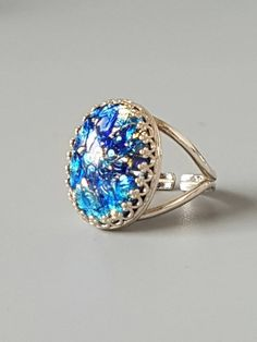 Check out this item in my Etsy shop https://www.etsy.com/uk/listing/267392961/blue-fire-opal-ring-925-sterling-silver
