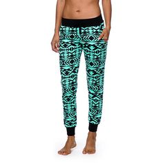 Take your style from basic to bold with these joggers cut from a comfortable and lightweight terry in a trendy mint and black tribal print.