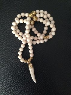 White beaded necklace with howlite horn pendant by DuoBeads, $45.00
