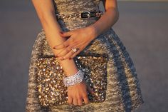 elegance. sequined clutch. perfect bracelet & rings.