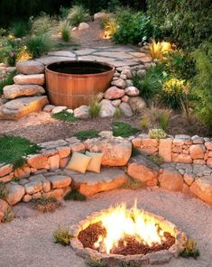 Stone landscaping around fire pit and hot tub; Grace Design Associates, Landscape Design and Build
