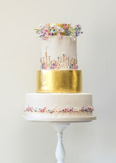 Gold leaf and meadow flowers wedding cake by Rosalind Miller Cakes ~ Beautifully Decorated and Delicious Award Winning Wedding Cakes  http://www.rosalindmillercakes.com/