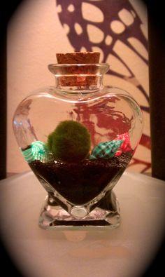 Baby Marimo moss ball inside of its heart by krissymolinaro. $15.99, via Etsy.